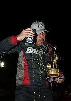 Nov. 11, 2012; Pomona, CA, USA: NHRA funny car driver Cruz Pedregon celebrates after winning the Auto Club Finals at at Auto Club Raceway at Pomona. Mandatory Credit: Mark J. Rebilas-