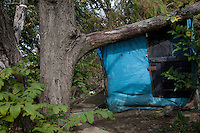 The shelter of a homeless person on the banks of the Arakawa River near Kita Senju, Tokyo, Japan Friday October 12th 2012