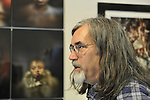 "Photographer Mark Andres, with Box Portrait of Marion Sheppard to his left, at Artist Reception for Seeing with Photography Collective SWPC, a group of visually impaired, sighted and totally blind photographers based in NYC, on Saturday, April 28, 2012, at African American Museum, Hempstead, New York, USA, and hosted by Long Island Center of Photography. Aperture published the group's ""Shooting Blind: Photographs by the Visually Impaired"" in 2005."