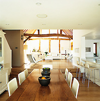 The open-plan living space comprises a sitting room raised slightly above the kitchen/dining area