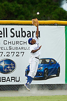 Burlington Royals left fielder Terrance Gore (4) makes a catch in front of the wall during the Appalachian League game against the Danville Braves at Burlington Athletic Park on July 19, 2012 in Burlington, North Carolina.  The Royals defeated the Braves 4-3.  (Brian Westerholt/Four Seam Images)