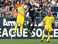 Brandon McDonald of Earthquakes fights for the ball against Brian Carroll of the Crew during the game at Buck Shaw Stadium in Santa Clara, California.  San Jose Earthquakes tied Columbus Crew, 2-2.