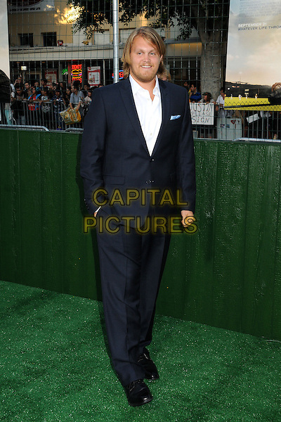 """Joe Massingill.""""Trouble With The Curve"""" Los Angeles Premiere held at the Regency Village Theatre, Westwood, California, USA..September 19th, 2012.full length suit hand in pocket blue white shirt .CAP/ADM/BP.©Byron Purvis/AdMedia/Capital Pictures."""