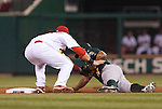 June 18, 2010       Oakland Athletics center fielder Rajai Davis (11) is tagged out at second base by St. Louis Cardinals second baseman Skip Schumaker (55) as Davis was caught stealing in the seventh inning.  The St. Louis Cardinals defeated the Oakland Athletics 6-4 in the first game of a three-game homestand at Busch Stadium in downtown St. Louis, MO on Friday June 18, 2010.