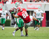 The Georgia Bulldogs played North Texas Mean Green at Sanford Stadium.  After North Texas tied the game at 21 early in the second half, the Georgia Bulldogs went on to score 24 unanswered points to win 45-21.  Georgia Bulldogs tight end Arthur Lynch (88)  Georgia Bulldogs tight end Arthur Lynch (88) makes a reception over the outstretched arm of North Texas Mean Green defensive back Lairamie Lee (27)