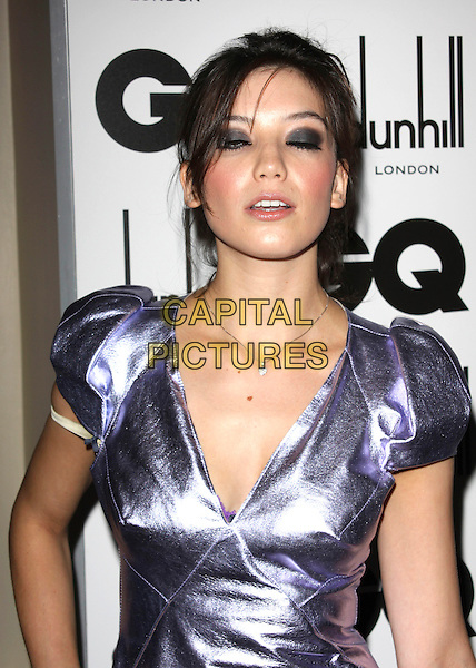 DAISY LOWE .Attending the GQ Men Of The Year Awards 2009 held at the Royal Opera House, Covent Garden, London, England, UK, September 8th 2009. arrivals portrait headshot v-neck shoulder pads puff shoulder necklace  purple shiny bra strap funny blinking black eyeshadow make-up .CAP/AH.©Adam Houghton/Capital Pictures.