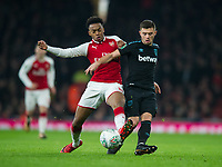 West Ham's Declan Rice and Arsenal's Joe Willock during the Carabao Cup QF match between Arsenal and West Ham United at the Emirates Stadium, London, England on 19 December 2017. Photo by Andrew Aleksiejczuk / PRiME Media Images.