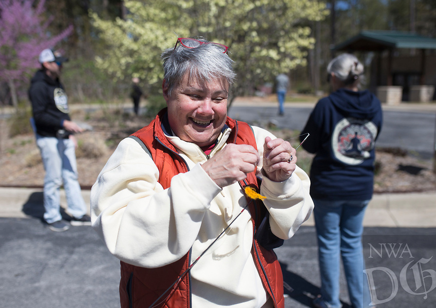 NWA Democrat-Gazette/CHARLIE KAIJO Leigh Wray of Fayetteville checks her line during a fly fishing class, Sunday, April 14, 2019 at Hobbs State Park in Rogers.<br /> <br /> Instructor Sallyann Brown, past recipient of the &ldquo;Woman of the Year&rdquo; and the &ldquo;Federation of Fly Fishers Educator of the Year&rdquo; awards from the Federation of Fly Fishers, Inc. taught a four hour fly fishing class.<br /> <br /> Participants learned four basic casts, the six basic types of flies (lures), how to cast and &ldquo;play&rdquo; the flies in the water, how to read water, how to wade, how to purchase and assemble equipment, how to store equipment and how to tie the four basic knots used by fly fishers.