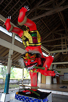 Ogoh-Ogoh (demon) called Kala Sunsgan (feets upward), Central Bali. Balinese New Year called Nyepi (around march according to lunar calendar),  is a silent day of meditation and spiritual purification. One day before exorcist rituals are held for purification and balance of polar powers of the universe, first at noon by a priest (exorcism called Caru or Tawur Agung) and later on after sunset in a popular, carneval-like procession of Ogoh-Ogoh, symbolizing bhuta kali (demon, bad spirits,bad habits),  so all the bad spirits leave the village and the island.  Loud, rhythmic music and special performances are part of the procession called Ngerupuk. Road crossings are major spots of exorcism and special ogoh-ogoh performance, since demons often like to dwell here. At Nyepi, the following day, there is 24 hours silence, no vehicle or people on the street, no light or fire, no working  all the bad spirits should think, the island is abandoned and leave the island. Day after Nyepi is a day of reconciliation  new year starts purified.