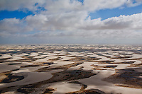 The Lençóis Maranhenses National Park (Parque Nacional dos Lençóis Maranhenses) is located in Maranhão state, in northeastern Brazil, just east of the Baía de São José, between 02º19'--02º45' S and 42º44'--43º29' W. It is an area of low, flat, occasionally flooded land, overlaid with large, discrete sand dunes. It encompasses roughly 1000 square kilometers, and despite abundant rain, supports almost no vegetation. The park was created on June 2, 1981