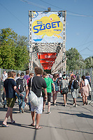 Participants enter head to the main gate of the Sziget festival held in Budapest, Hungary on August 10, 2011. ATTILA VOLGYI