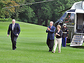 Washington, D.C. - July 20, 2008 -- Outgoing Deputy White House Chief of Staff Joe Hagin, left, is all smiles as he is applauded by United States President George W. Bush, center, and first lady Laura Bush, right, as they arrive on the South Lawn of the White House following a week-end trip to the west coast and his ranch at Crawford, Texas.<br /> Credit: Ron Sachs / Pool via CNP