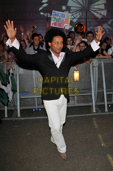 MOHAMMED MOHAMMED.Housemates enter the Big Brother House for Big Brother 9,.Borehamwood, England, 5th June 2008..arrivals full length black jacket hands waving white trousers hands waving.CAP/PL.©Phil Loftus/Capital Pictures