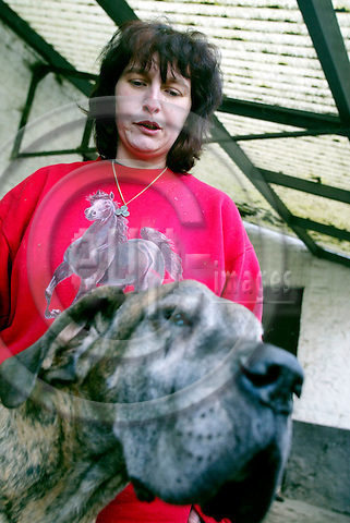 DE PINTE - BELGIUM - 24 FEBRUARY 2004--Regina LOUF, known as the anonymous witness XI, was the first of 11 people to come forward to talk of their harrowing experiences at the hands of Belgium's paedophile networks, after the Marc Dutroux case began. Here with one of her many breedingdogs-- PHOTO: ERIK LUNTANG / EUP-IMAGES