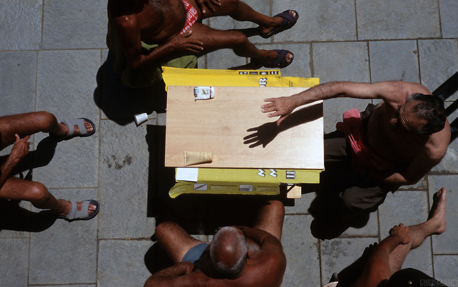 Summer brings on dark tans and discussions along the beach in Barcelona, Spain.