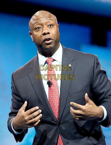 United States Senator Tim Scott (Republican of South Carolina) makes remarks at CPAC 2013 At the Gaylord National Resort & Convention Center in National Harbor, Maryland, USA, .March 14th, 2013..half length red tie grey suit .CAP/ADM/CNP/RS.©Ron Sachs/CNP/AdMedia/Capital Pictures.