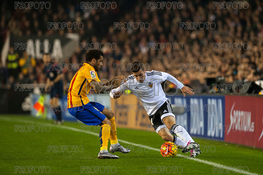 VALENCIA, SPAIN - DECEMBER 5: Gaya, Dani Alves during BBVA LEAGUE match between Valencia C.F. and FC Barcelona at Mestalla Stadium on December 5, 2015 in Valencia, Spain