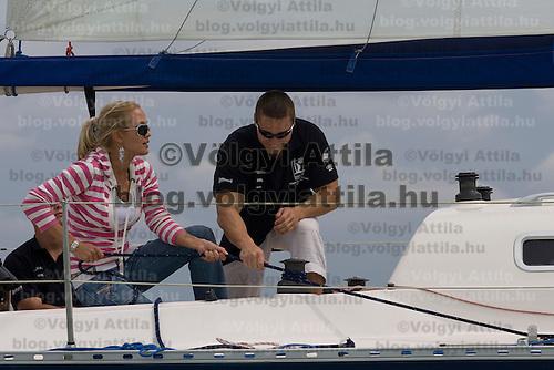Hungarian celebrity Orsolya Sandor posing for photographers on board the Nautica class ship Blues. 40th Blue Ribbon Regatta race with 570 participating yachts sailing the 160 km course around Lake Balaton near Balatonfured. Hungary. Friday, 18. July 2008. ATTILA VOLGYI