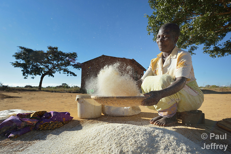 Kefless Mbunge sifts flour in Chibamu Jere, Malawi, where the Maternal, Newborn and Child Health program of the Livingstonia Synod of the Church of Central Africa Presbyterian has helped families stay healthy.