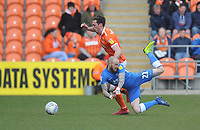 Blackpool's Ben Heneghan vies for possession with Peterborough United's Marcus Maddison<br /> <br /> Photographer Kevin Barnes/CameraSport<br /> <br /> The EFL Sky Bet League One - Blackpool v Peterborough United - Saturday 13th April 2019 - Bloomfield Road - Blackpool<br /> <br /> World Copyright &copy; 2019 CameraSport. All rights reserved. 43 Linden Ave. Countesthorpe. Leicester. England. LE8 5PG - Tel: +44 (0) 116 277 4147 - admin@camerasport.com - www.camerasport.com