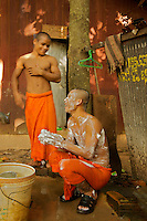 Monks at the Monastery cleaning and washing with soap and foam on their body. Siem Reap Cambodia