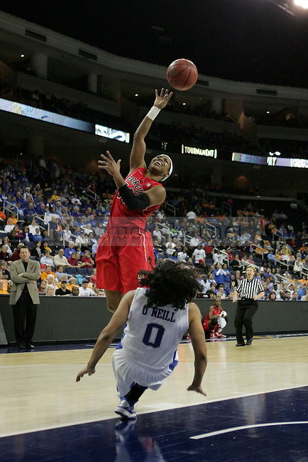 UGA guard Jasmine James shoots while knocking down UK guard Jennifer O'Neill during the second half of the University of Kentucky women's basketball game vs. University of Georgia during the SEC tournament The Arena at Gwinnett Center in Duluth, Ga. on Saturday, March 9, 2013. The aggression from the two teams made for a heated game. UK won 68-30. Photo by Genevieve Adams | Staff