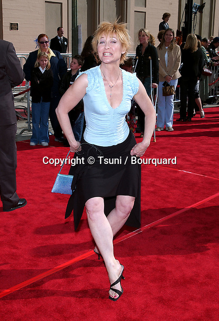 Dee Wallace Stone posing at the 20th anniversary of the premiere of E.T. The Extra Terrestrial at the Shrine Auditorium in Los Angeles. March 16, 2002.