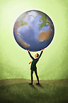 Illustrative image of businessman holding planet representing global leader