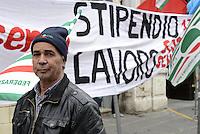 Roma, 13 Dicembre 2013<br /> Piazza Santi Apostoli<br /> Manifestazione durante lo sciopero nazionale del settore edilizio organizzata dai sindacati  FILLEA CGIL, FILCA CISL E FENEAL UIL, per il rinnovo del contratto.