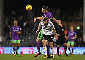31st October 2017, Craven Cottage, London, England; EFL Championship football, Fulham versus Bristol City; Milan Djuric of Bristol City heads the ball over Tim Ream of Fulham