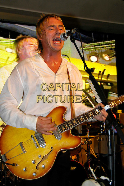 PAUL WELLER.AT HMV, London..October 10th, 2005.half length stage live gig performance music guitar singing.www.capitalpictures.com.sales@capitalpictures.com.©Capital Pictures