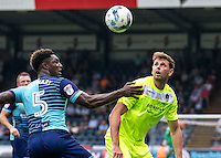 Chris Porter of Colchester United battles with Anthony Stewart of Wycombe Wanderers during the Sky Bet League 2 match between Wycombe Wanderers and Colchester United at Adams Park, High Wycombe, England on 27 August 2016. Photo by Liam McAvoy.
