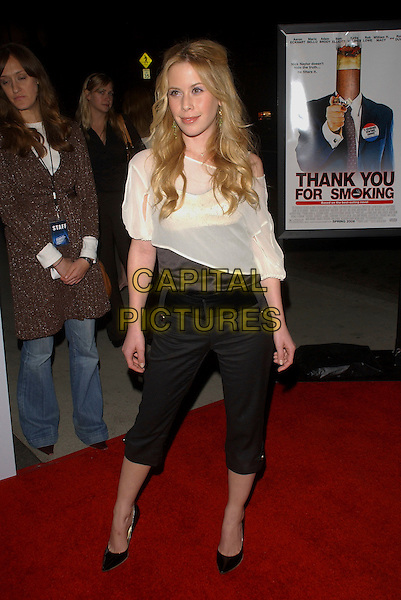 "TARA LAPINSKI.L.A. Premiere of ""Thank You for Smoking"" held at The Directors Guild of America in Hollywood, California, USA. March 16th, 2006 .Ref: DVS.full length black cropped trousers white sheer.www.capitalpictures.com.sales@capitalpictures.com.Supplied By Capital PIctures"