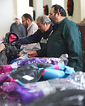 WATERBURY, CT- 27 November 2015-112715EC02--   Paul DiStasio (L) and Stephen Rice (R) hand out coats at St. Anne's in Waterbury Friday. It was one of six locations where Knights of Columbus distributed free coats for children. The Waterbury spot had nearly 500 coats to give away. 2,000 coats were distributed througout the state. Erin Covey Republican-American.
