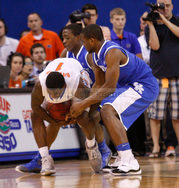 UK guards Doron Lamb and Darius Miller double team Florida's Kenny Boynton during the second half of the University of Kentucky's men basketball game against University of Florida on 3/4/12 at the O'Connell Center in Gainesville, Fl. Photo by Quianna Lige | Staff