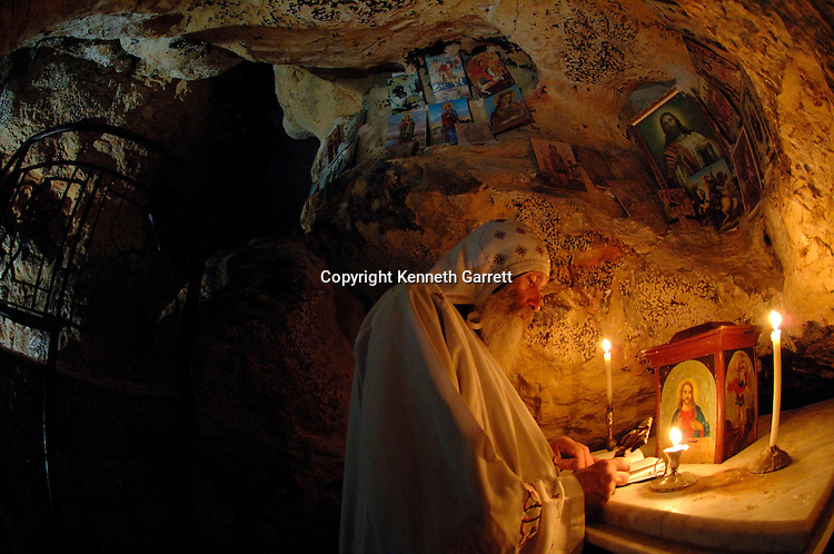Saint Anthony's Monastery, Father Lazarus, Coptic monk, in the orignial cave of St. Anthony, Egypt, Gospel of Judas; Codex Tchacos; Critical Edition, Gnostic text;Geneva