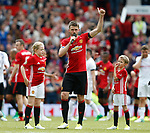 Michael Carrick flanked by his children Louise and Jacey, thanks the crowd during the Michael Carrick Testimonial match at the Old Trafford Stadium, Manchester. Picture date: June 4th 2017. Picture credit should read: Simon Bellis/Sportimage