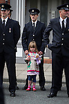 © Joel Goodman - 07973 332324 . 02/09/2013 . Bury , UK . A young girl amongst 100s of fire service personnel lining the streets of Bury leading up to the church . The funeral of fireman Stephen Hunt at Bury Parish Church today (Tuesday 3rd September 2013) . Stephen Hunt died whilst tackling a blaze at Paul's Hair World in Manchester City Centre in July 2013 . Photo credit : Joel Goodman