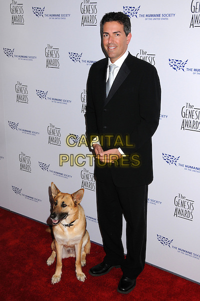 WAYNE PACELL E, Humane Society CEO.22nd Annual Genesis Awards at the Beverly Hilton Hotel, Beverly Hills, California, USA..March 29th, 2008.full length black suit dog animal pet.CAP/ADM/BP.©Byron Purvis/AdMedia/Capital Pictures.
