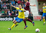 Hearts v St Johnstone....06.05.12   SPL.Jody Morris is fouled by Ian Black.Picture by Graeme Hart..Copyright Perthshire Picture Agency.Tel: 01738 623350  Mobile: 07990 594431