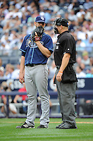 Tampa Bay Rays pitcher James Shield #33 with home plate umpire Scott Barry during a game against the New York Yankees at Yankee Stadium on September 21, 2011 in Bronx, NY.  Yankees defeated Rays 4-2.  Tomasso DeRosa/Four Seam Images