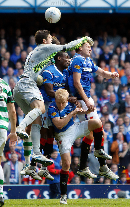 Fraser Forster flaps at the ball as Edu, Goian and Naismith attack the Celtic keeper
