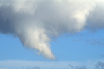 Tornadic funnel cloud descending out of cumulonimbus storm cloud