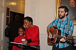 Actress and singer Rhonda Ross (Another World) and son Raif sings Christmas Carols  - Hearts of Gold links to a better life celebrates Christmas with a party #2 for mothers and their children on December 17, 2016 in New York City, New York with arts and crafts, a great turkey dinner with all the goodies and then the children met Santa Claus and had a photo with him as he gave them gifts. (Photo by Sue Coflin/Max Photos)