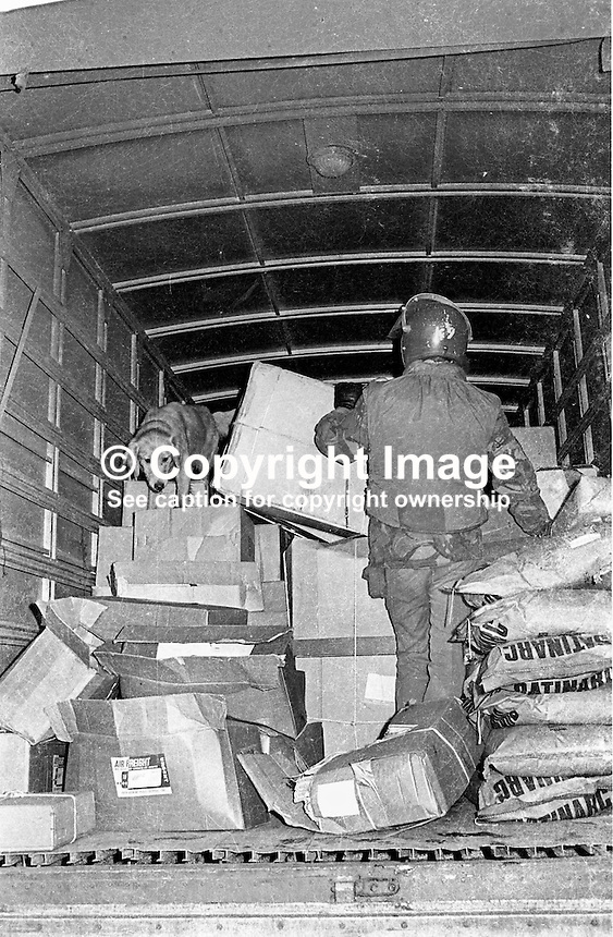 Delivery vehicle is checked by soldier and dog trained to sniff out explosives at a checkpoint at Royal Avenue, Belfast. British Army. N Ireland Troubles. Ref: 19741120638<br /> <br /> Copyright Image from Victor Patterson, 54 Dorchester Park, Belfast, UK, BT9 6RJ<br /> <br /> t: +44 28 90661296<br /> m: +44 7802 353836<br /> vm: +44 20 88167153<br /> e1: victorpatterson@me.com<br /> e2: victorpatterson@gmail.com<br /> <br /> For my Terms and Conditions of Use go to www.victorpatterson.com