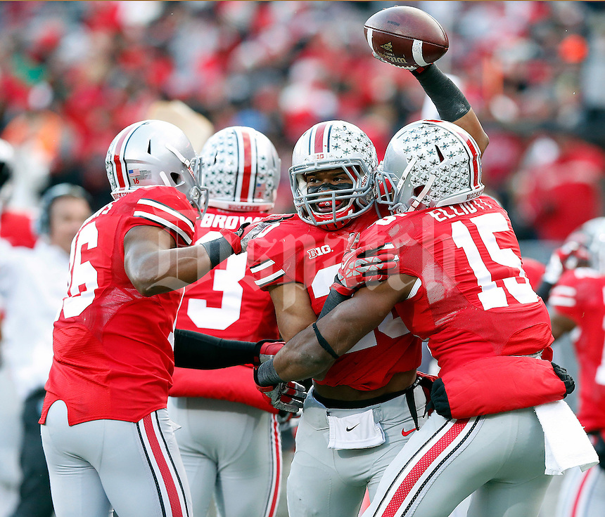 Ohio State Buckeyes defensive back Ron Tanner (20) celebrates after recovering the ball after a blocked punt against Indiana Hoosiers during the second quarter of their College football game at Ohio Stadium in Columbus, Ohio on November 23, 2013.  (Dispatch photo by Kyle Robertson)