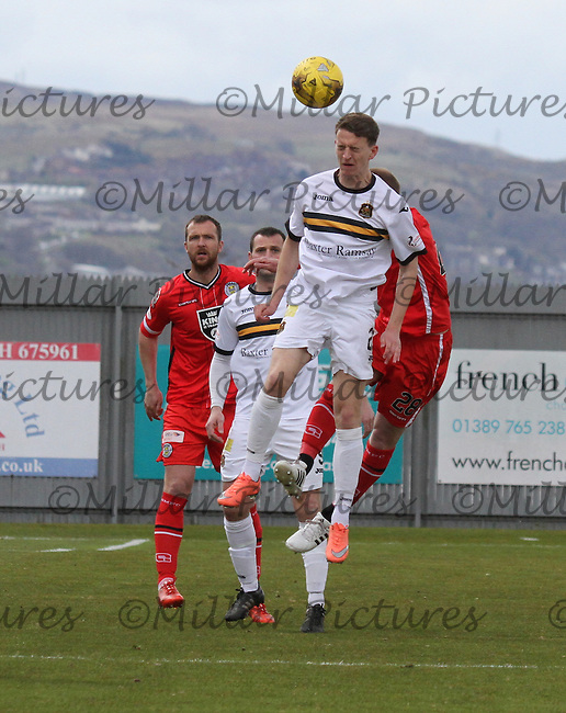 Tom Walsh winning the header in the Dumbarton v St Mirren Scottish Professional Football League Ladbrokes Championship match played at The Cheaper Insurance Direct Stadium, Dumbarton on 23.4.16.