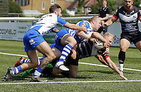 Scott Leatherbarrow dives over for the opening try for London during the Kingstone Press Championship game between London Broncos and Workington at Ealing Trailfinders, Ealing, on Sun June 5, 2016