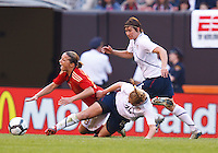 22 MAY 2010:  Germany's Inka Grings, USA's Rachel Buehler #26 and USA's Amy LePeilbet #6 during the International Friendly soccer match between Germany WNT vs USA WNT at Cleveland Browns Stadium in Cleveland, Ohio. USA defeated Germany 4-0 on May 22, 2010.
