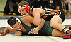 Dom Micari of Sachem East, top, gets an advantage on Brandon Ortiz of Brentwood during a Suffolk County varsity wrestling meet at Brentwood High School on Friday, Jan. 8, 2016. Micari won the 170 pound match by major decision 12-4 to help Sachem East to a 34-17 victory.